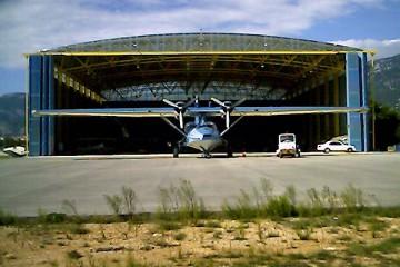 Space frame hangar with folding doors open